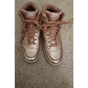 Rose gold Nike wedge sneakers
